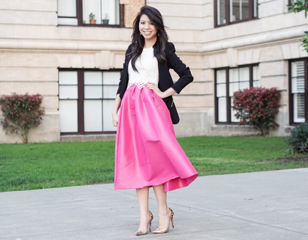 bold in pink midi skater skirt with crop top and blazer