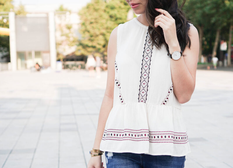 Embroidered Peplum Top and Ripped Jeans
