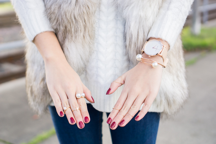 striped faux fur vest, gold pearl jewelry, marc bale watch