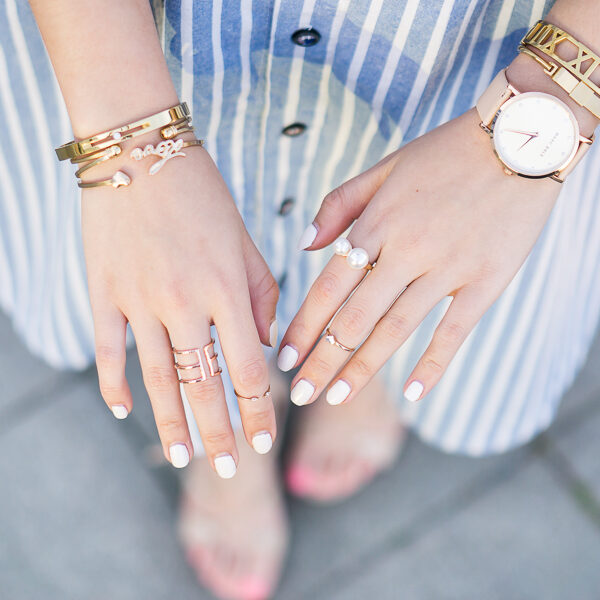 gold rings and bracelets, white nails