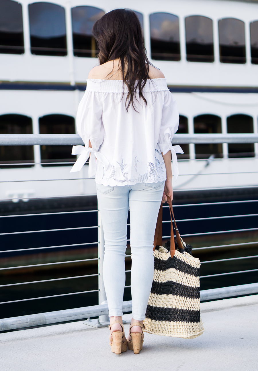 white off shoulder top outfit, light blue jeans, straw beach tote, cork wedges, spring fashion, petite fashion blog