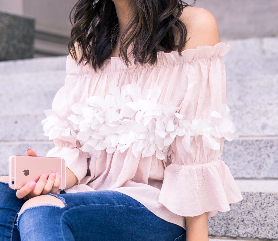 Cute and casual summer outfit wearing a blossom cute off the shoulder top
