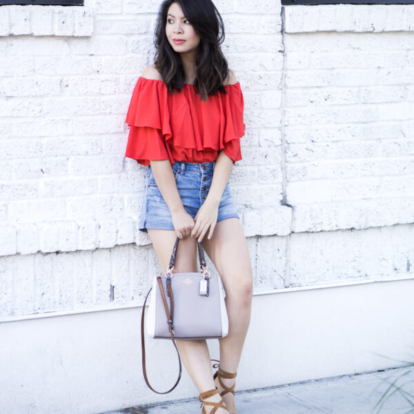Denim shorts outfit with red off the shoulder top