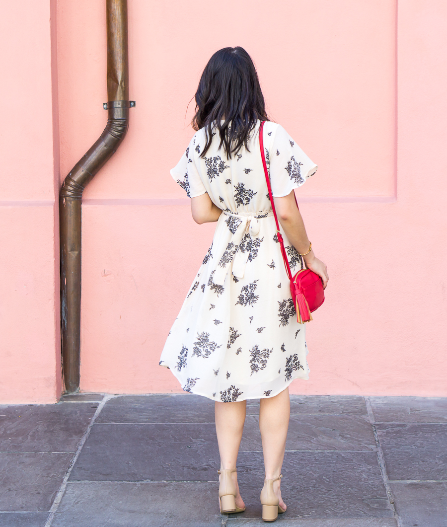 Floral wrap dress with ankle strap sandals in New Orleans French Quarter | Petite Fashion Blog