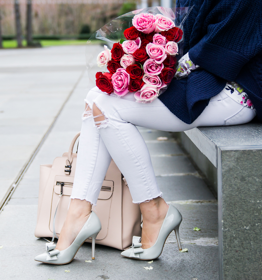 White jeans, bow pumps, roses