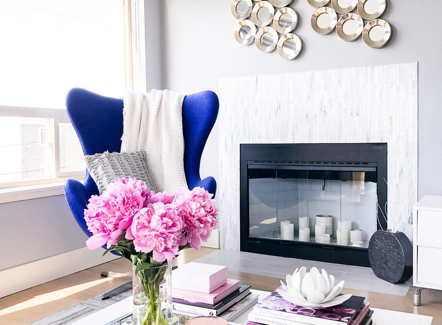 Modern chic living room, blue egg chair, peonies, Seattle fashion blogger