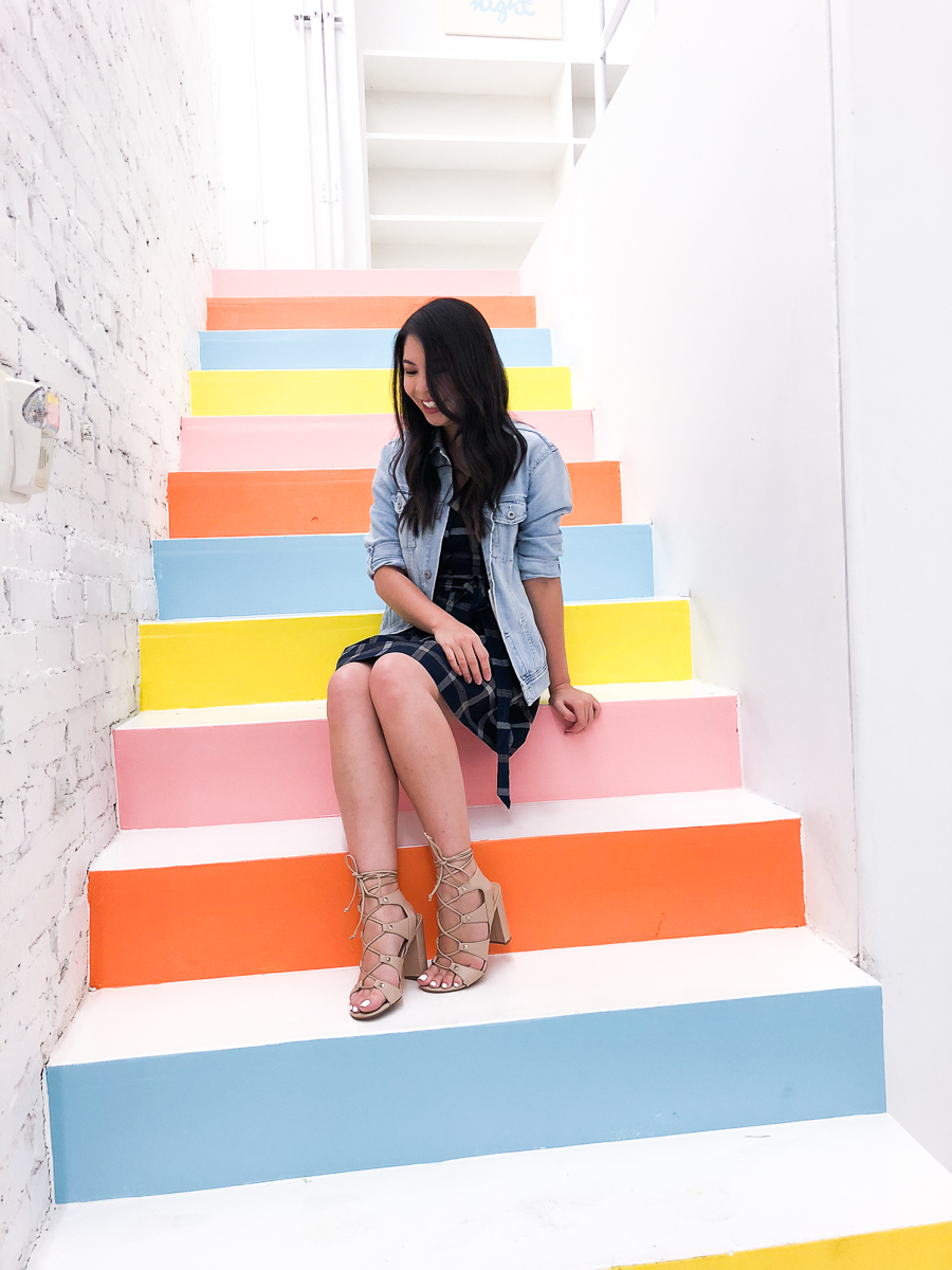 Molly Moon rainbow stairs, plaid dress, denim jacket, Seattle fashion blogger