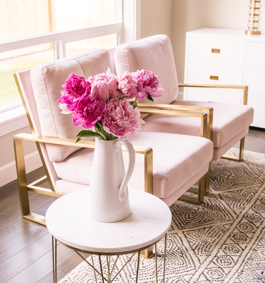 Living room pink chairs, blush chairs, gold legs, pink peonies