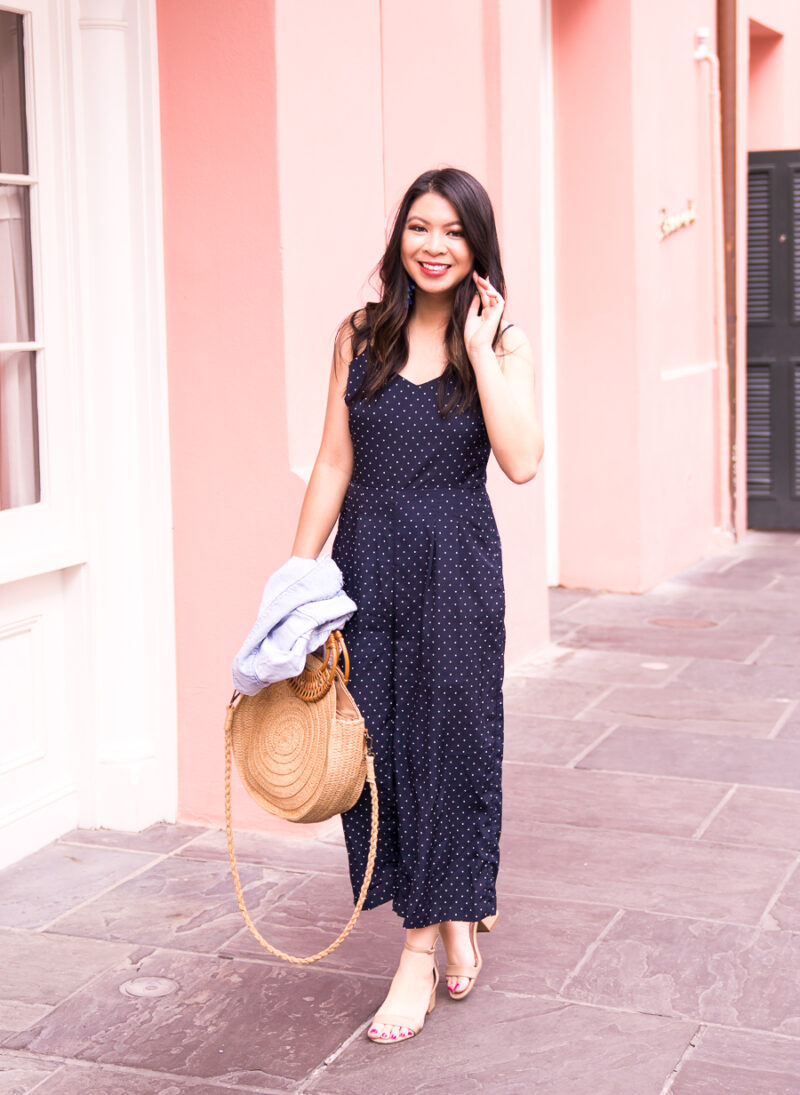 c879a2338a Just A Tina Bit fashion blogger wearing a navy polka dot jumpsuit