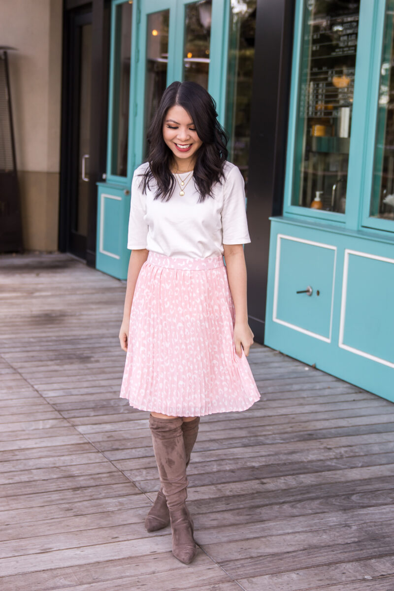f817dacc56 ... Seattle fashion blogger from Just A Tina Bit wears a leopard pleated  skirt with a white